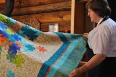 Juananne with Ev Butermans Quilt.JPG