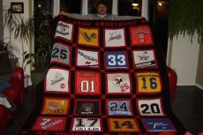 Aaron and his hockey quilt.JPG